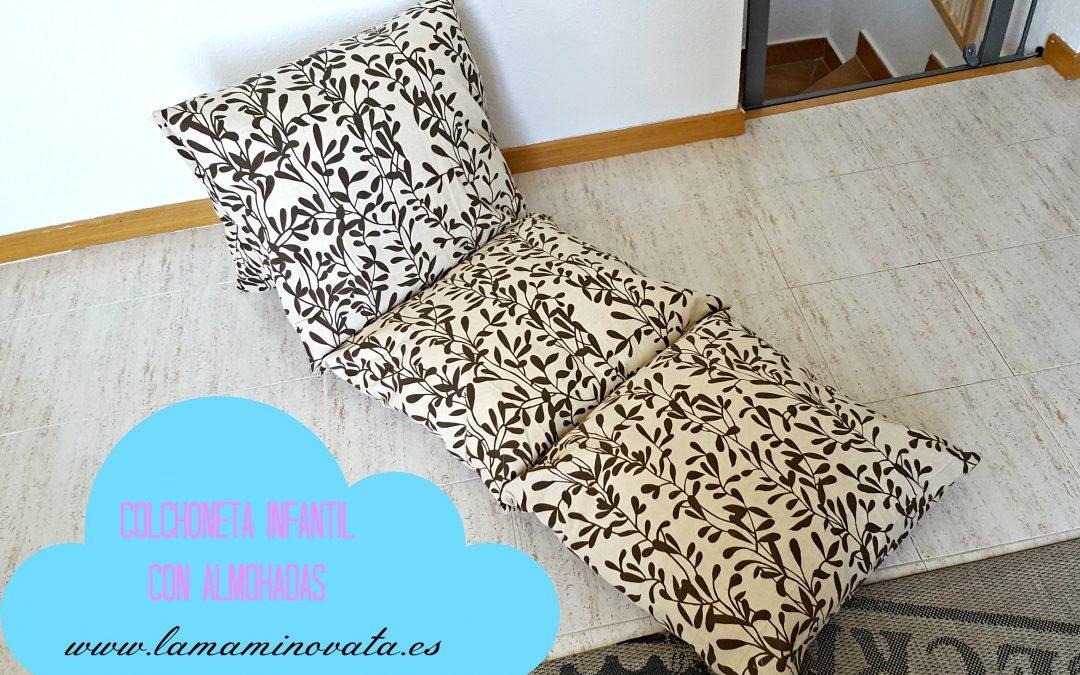 Colchoneta infantil con almohadas